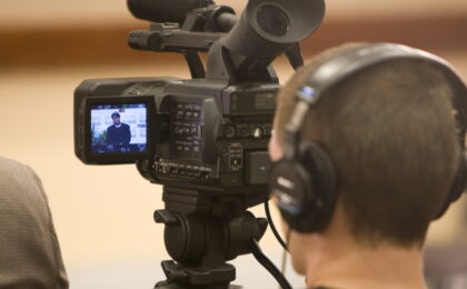 Image of a camera man shooting an interview